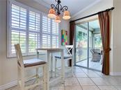 Kitchen eating area - plantation shutters throughout the condo. - Condo for sale at 9453 Discovery Ter #201c, Bradenton, FL 34212 - MLS Number is A4423314