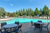 Jr. Olympic Pool heated to 85 degrees year round, lap lanes and water aerobics. - Condo for sale at 9453 Discovery Ter #201c, Bradenton, FL 34212 - MLS Number is A4423314