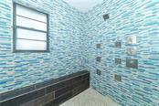 Master shower with bench seating and 9 shower heads. - Single Family Home for sale at 8106 Timber Lake Ln, Sarasota, FL 34243 - MLS Number is A4423770
