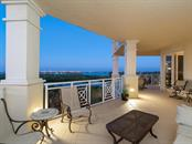 Main balcony at twilight. - Condo for sale at 2050 Benjamin Franklin Dr #a702, Sarasota, FL 34236 - MLS Number is A4424335
