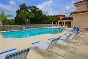 Community pool - Single Family Home for sale at 702 Anna Hope Ln, Osprey, FL 34229 - MLS Number is A4427993