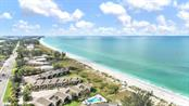 Aerial beach South - Villa for sale at 717 Spanish Dr N, Longboat Key, FL 34228 - MLS Number is A4438337