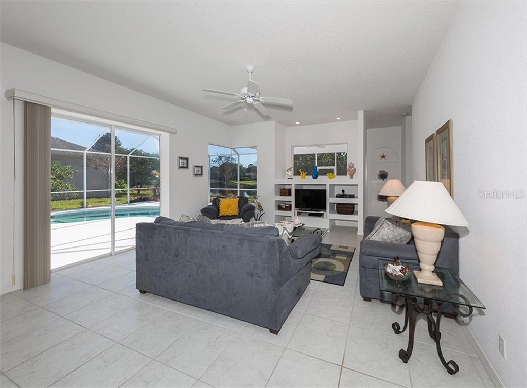 Family room with sliders to pool - Single Family Home for sale at 2201 Sonoma Dr E, Nokomis, FL 34275 - MLS Number is N6103410